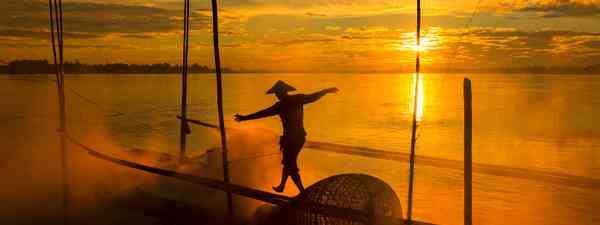 A fisherman on the Mekong Delta in Vietnam (Shutterstock)