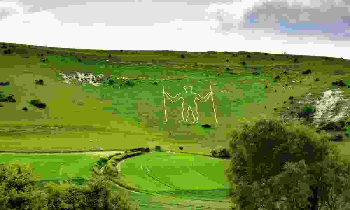 Long view of the Long Man (Dreamstime)
