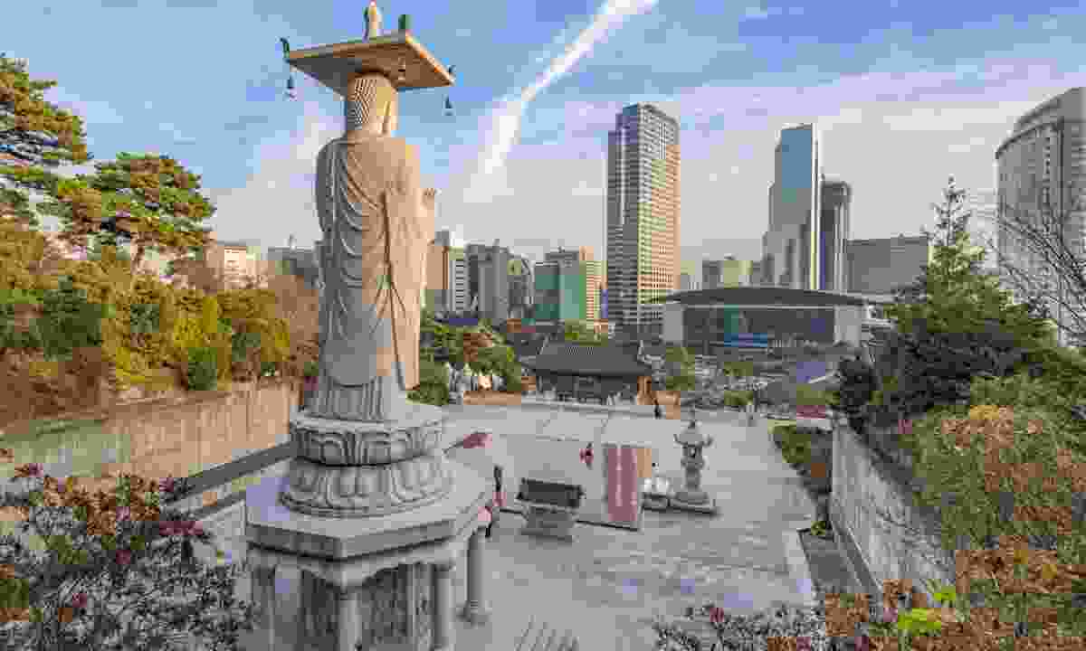 The giant Buddha of Bongeunsa looking towards Seoul (Dreamstime)