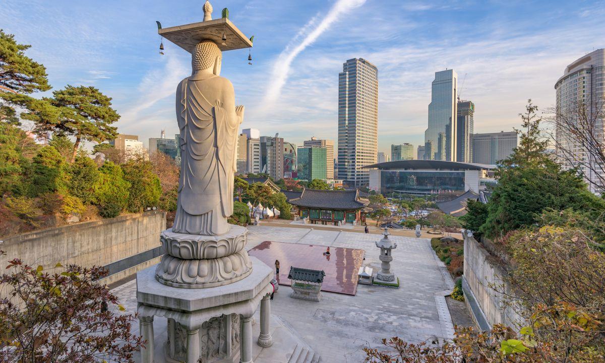 The giant Buddha of Bongeunsa looking towards Seoul (Dreamstime)