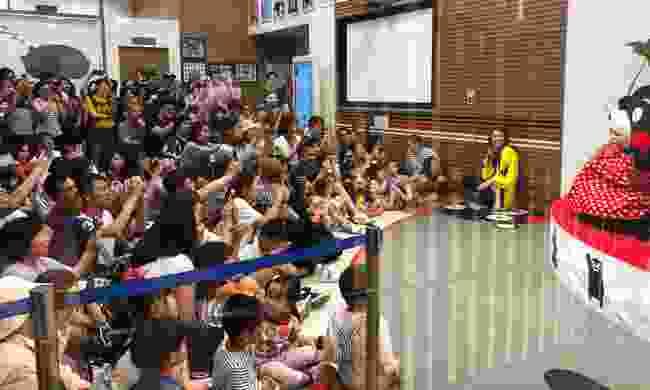 Adoring fans look on in Kumamon Square as Kumamon performs