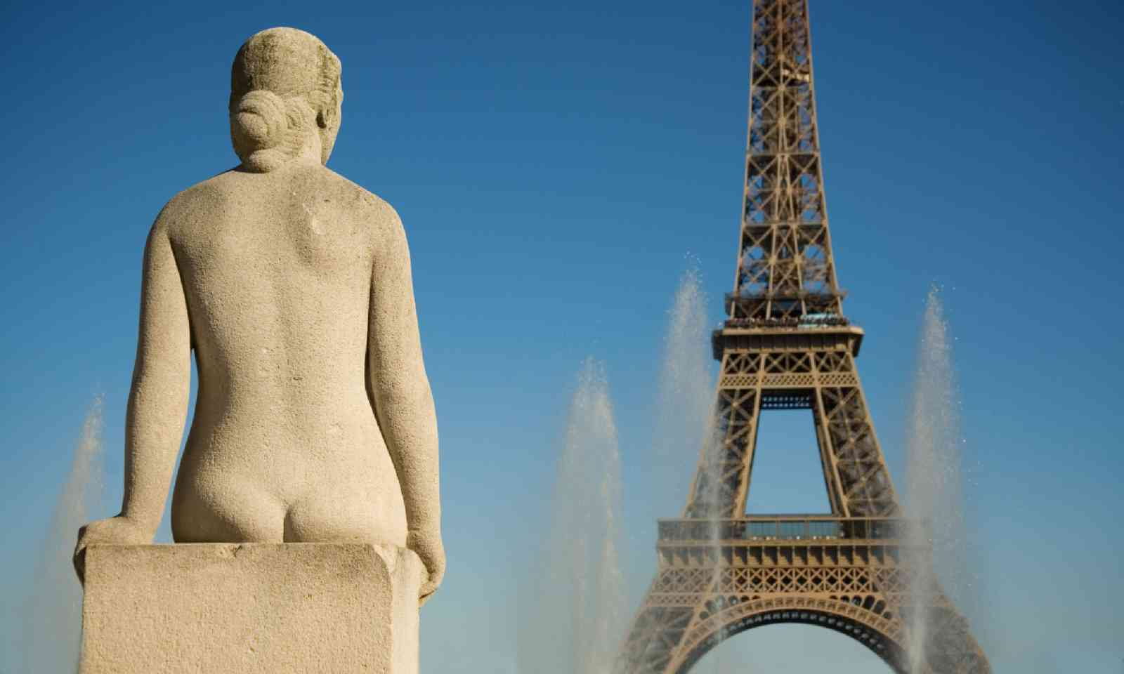 Statue of woman at the Trocadero looking at the Eiffel Tower (Shutterstock)