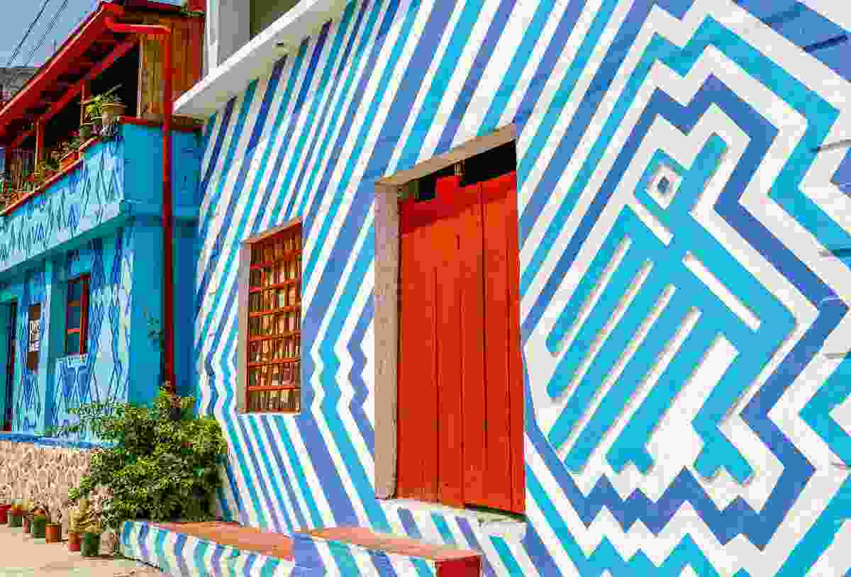 A brightly painted building in Santa Catarina Palopo's main square (Sarah Gilbert)