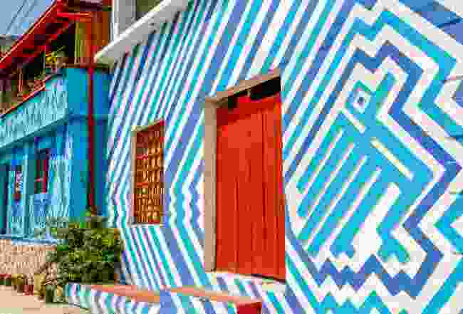 A brightly painted building in Santa Catarina Palopo's main square (Sarah Gilbert)