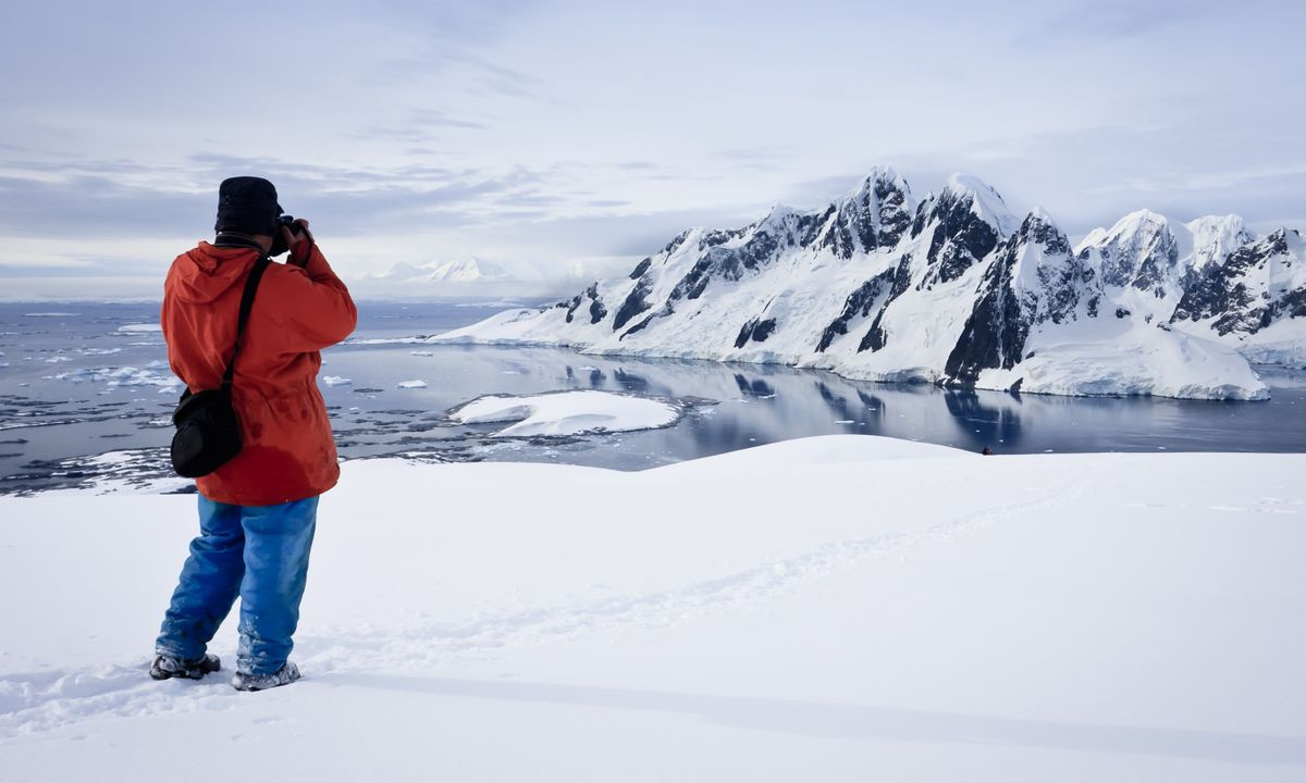 Photographer on Antarctica (Dreamstime)