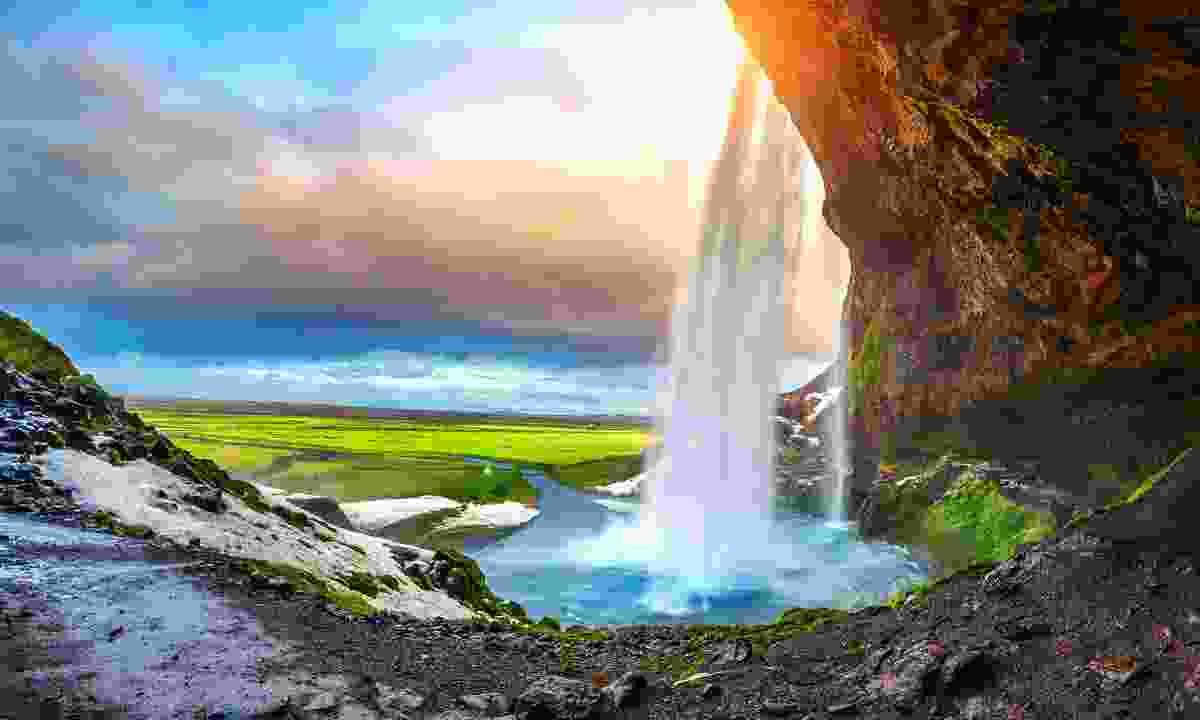 Seljalandsfoss waterfall as the sun sets (Shutterstock)