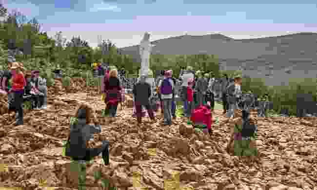 Pilgrims on Apparition Hill (Shutterstock)