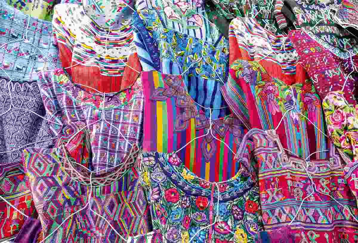 Traditional huipils on display on Dona Encarnacion's market stall (Sarah Gilbert)