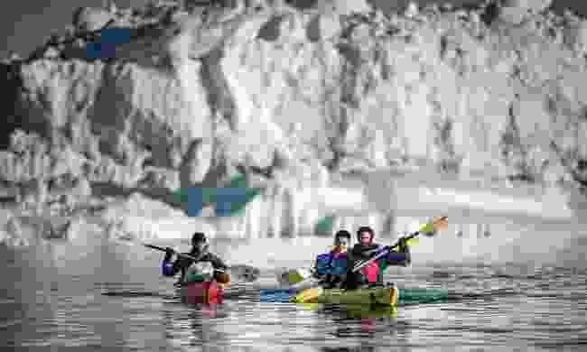 Paddling near an iceberg in the Disko Bay (Mads Pihl)