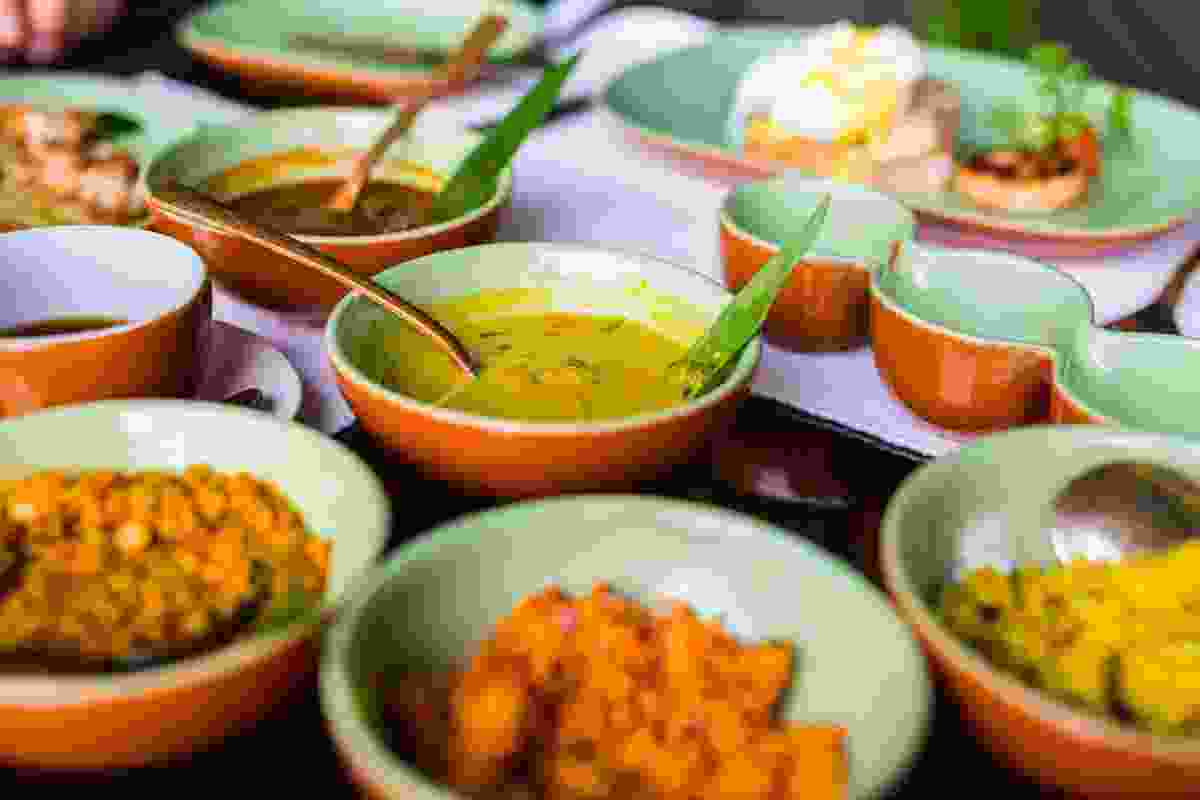 A typical spread of delicious curry and rice dishes in Colombo, Sri Lanka (Shutterstock)