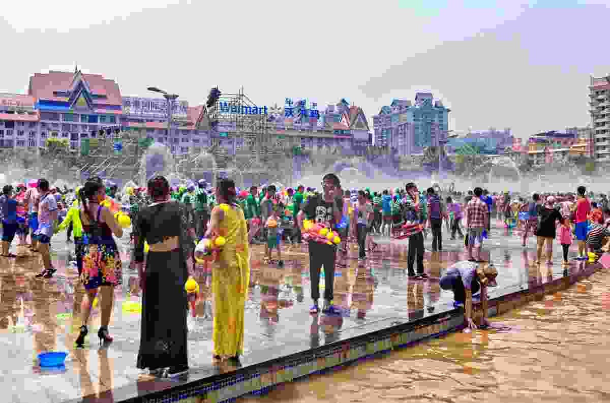 Water fights during Songkran (Dreamstime)