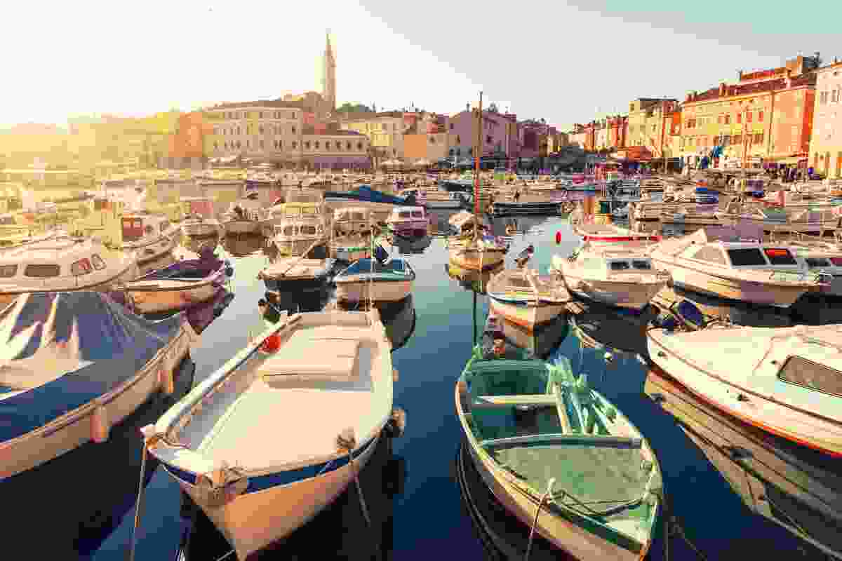 Head out onto Rovinj's crystal clear waters via boat trip (Shutterstock)