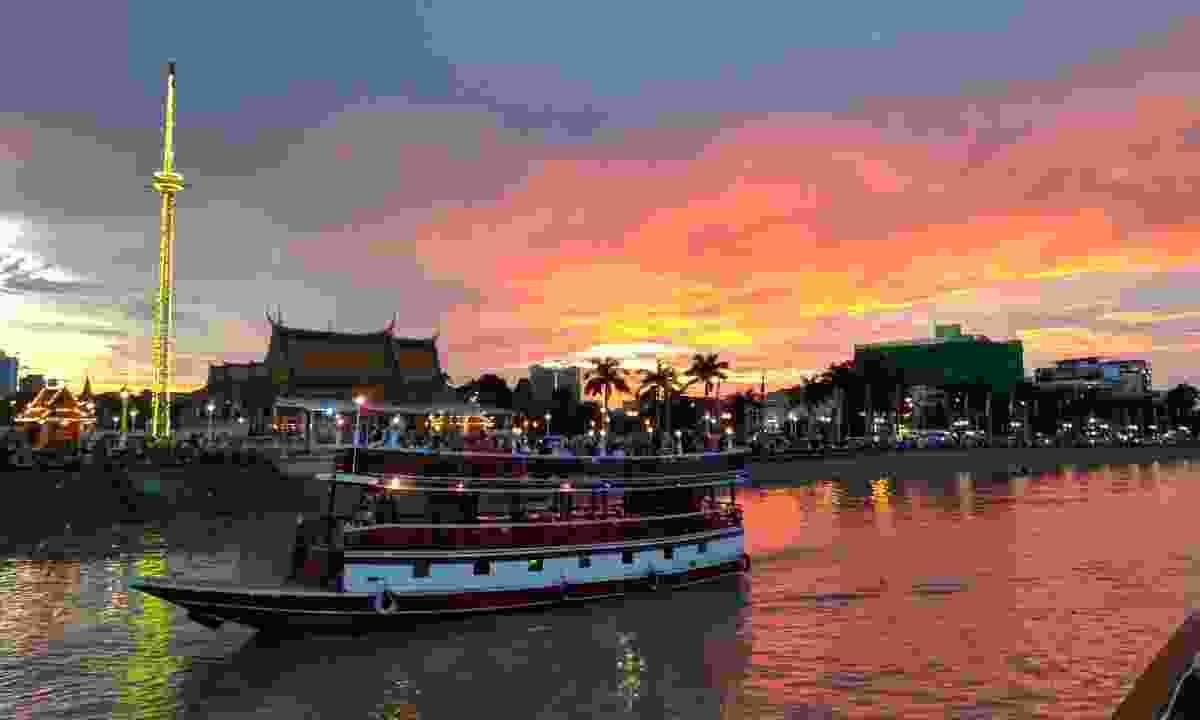 Cruising past Phnom Penh during sunset (Shutterstock)