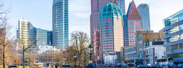 A cyclist enjoys the view of Den Haag's well-loved skyline (Shutterstock)