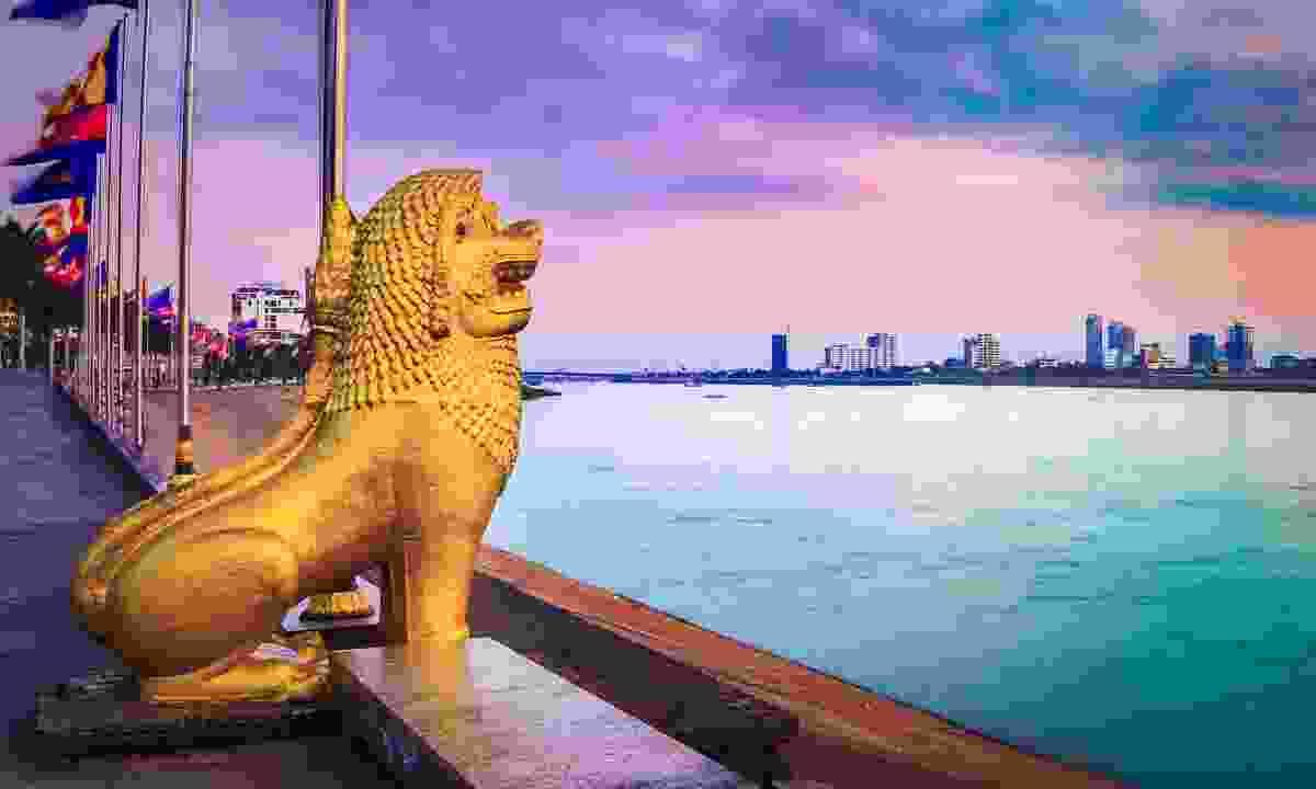 The smart riverfront of Pnom Penh at sunrise (Shutterstock)