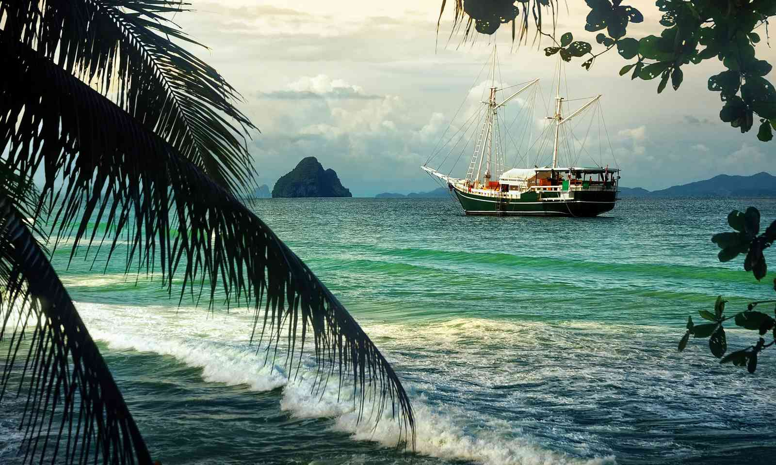 Old sailing ship in tropical landscape (Shutterstock.com)