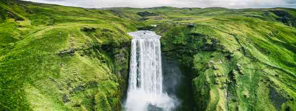 Skogafoss waterfall is one of many wild and wonderful Reykjavik day trips (Shutterstock)