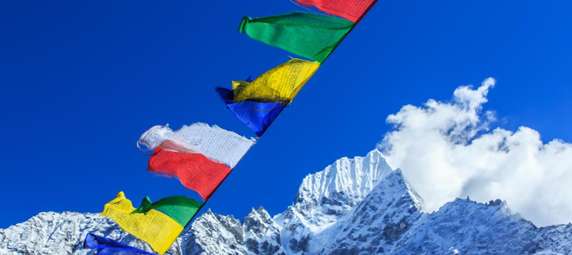 Prayer flags flutter over the Nepalese Himalaya (LVW/wanderlust.co.uk/mywanderlust)