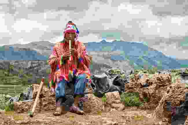 A local in traditional dress, Peru (Shutterstock)