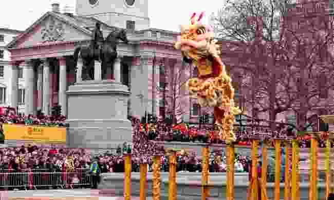 Lion Dancers leap across the poles in Trafalgar Square (Shutterstock)