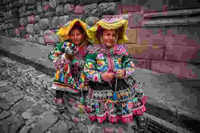 Local women in Ollantaytambo, Peru (Shutterstock)
