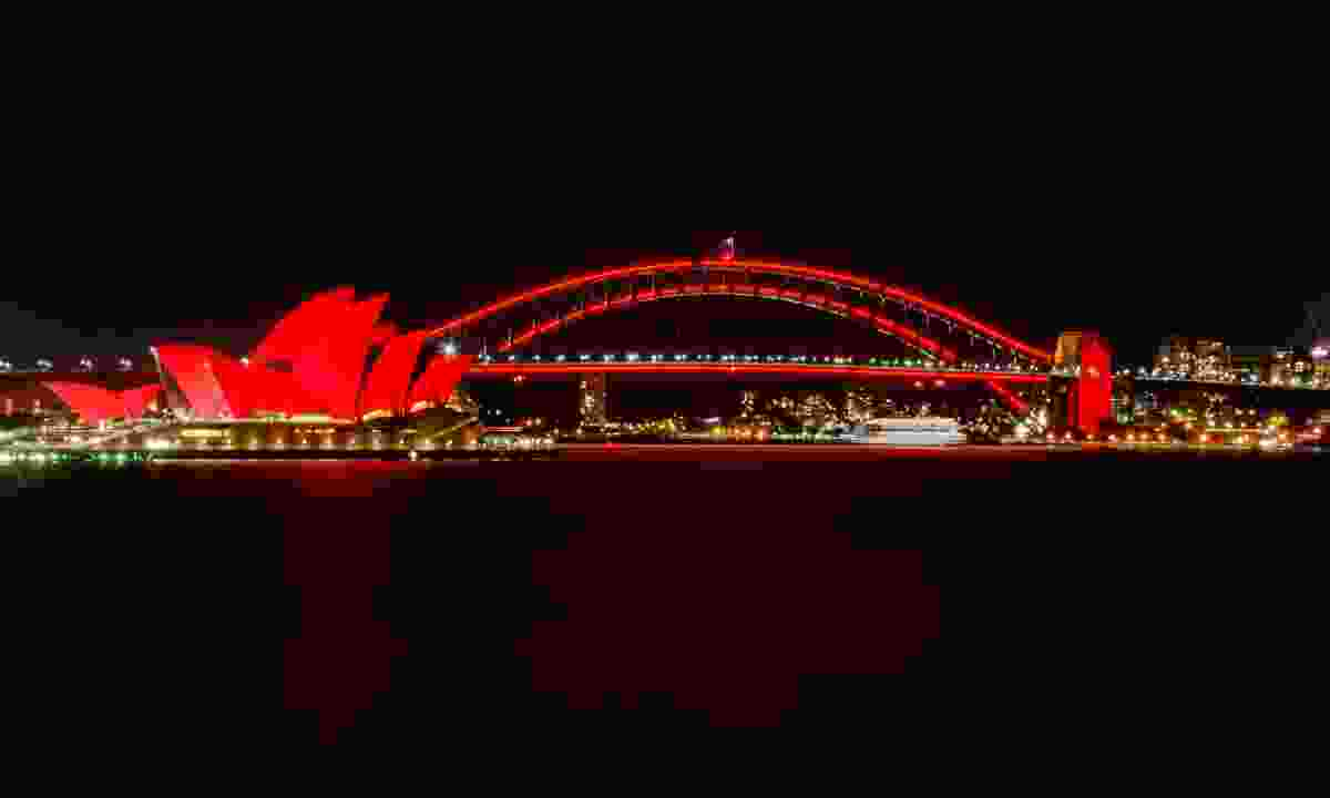 Sydney Harbour Bridge and the Opera House illuminated red for Chinese New Year (Shutterstock)