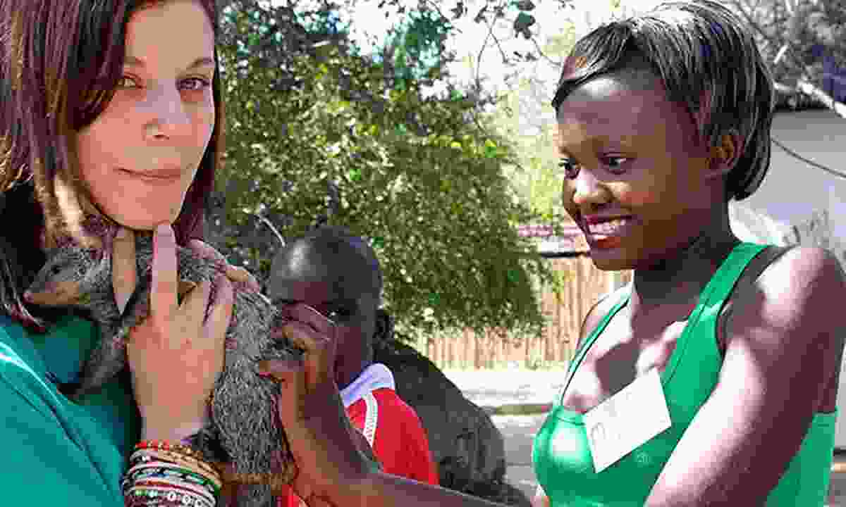 A volunteer at the Wildlife Orphanage in South Africa (The Great Projects)