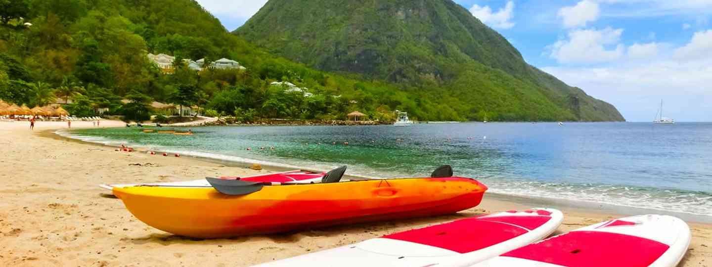 St. Lucia�s iconic Pitons,a pair of volcanic spires that vault upward from the Caribbean Sea.They define one of the region�s most romantic destination