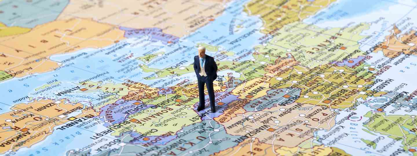 Confused traveller on a map (Dreamstime)
