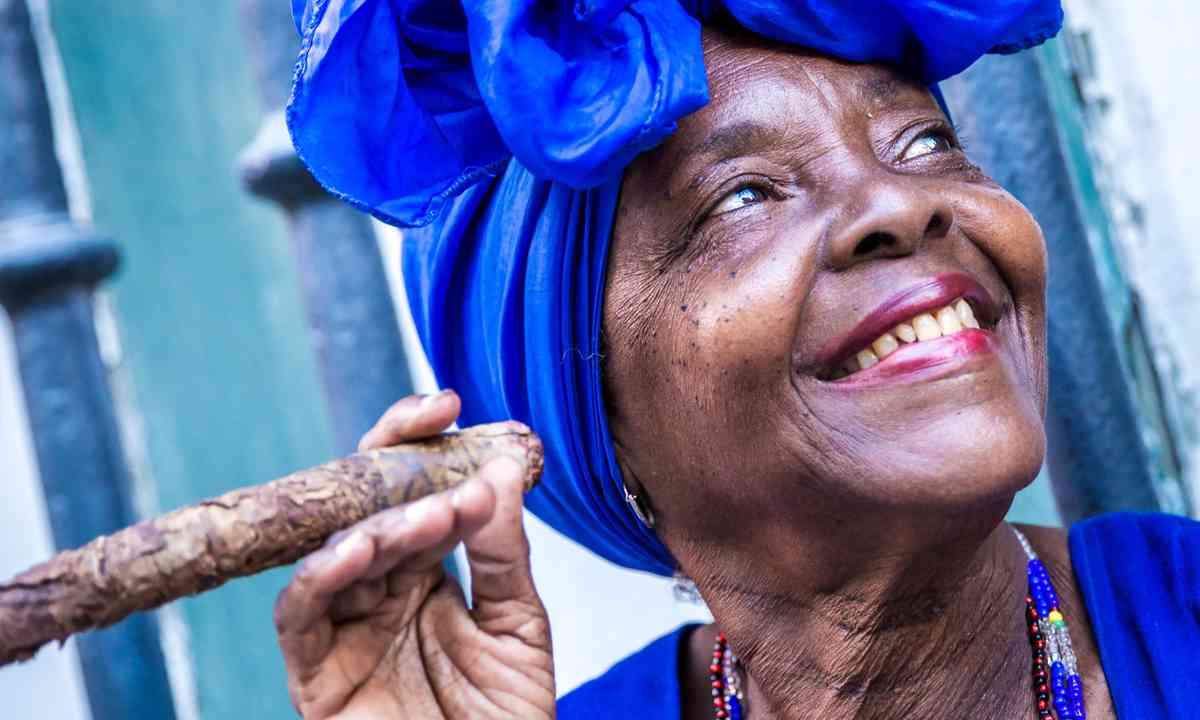 Local lady smoking a cigar in Havana (Shutterstock.com)
