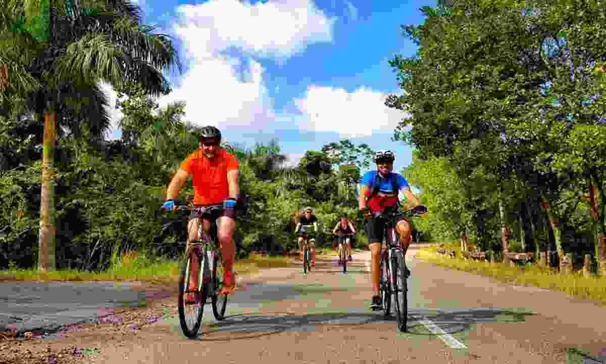 Cyclists outside Las Terrazas (Intrepid)