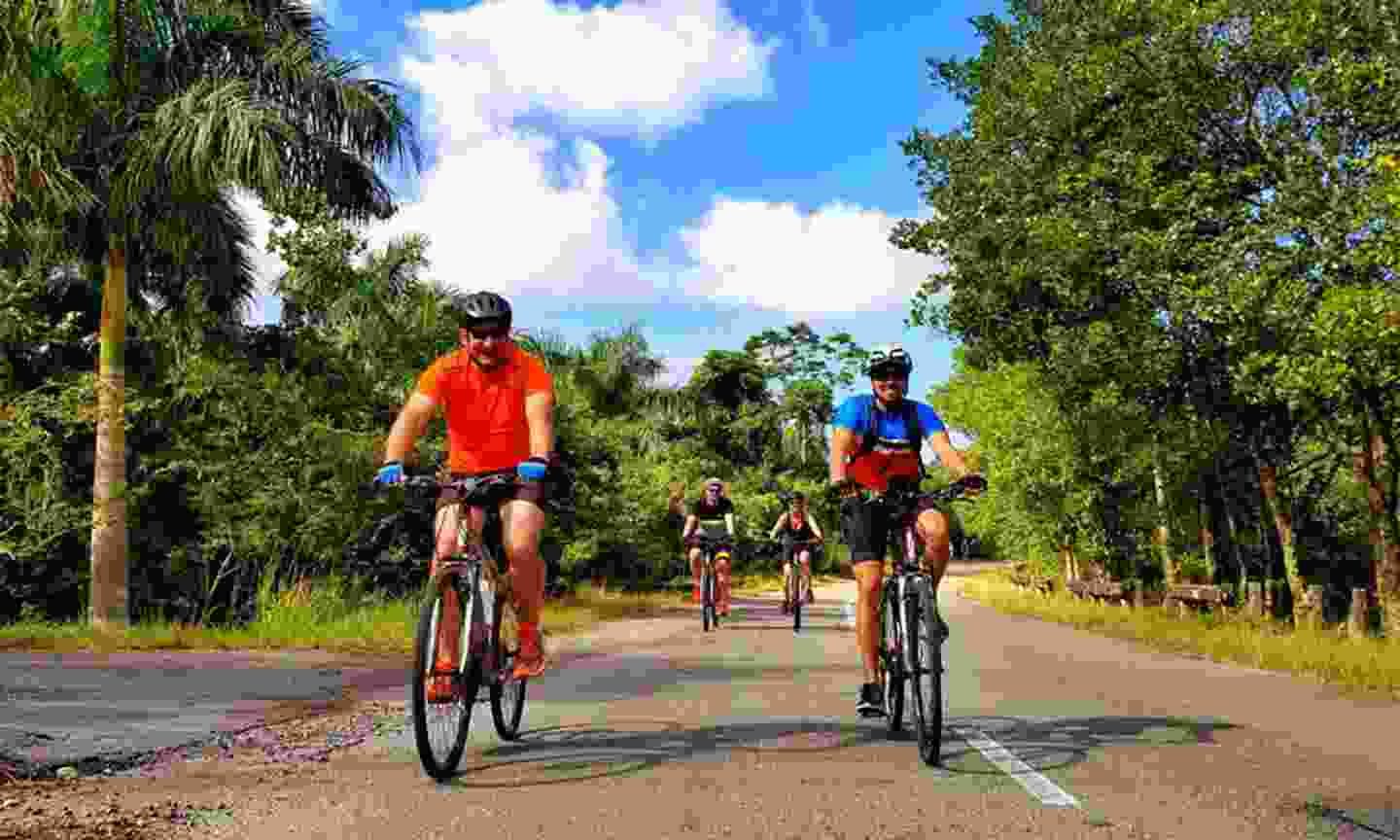 Cyclists outside Las Terrazas (Intrepid)
