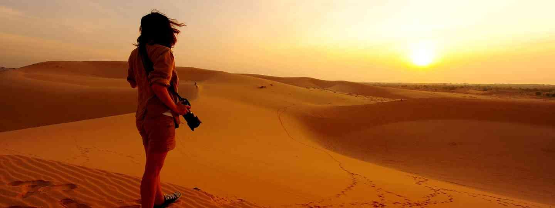 Photographer in the desert (Shutterstock: see credit below)