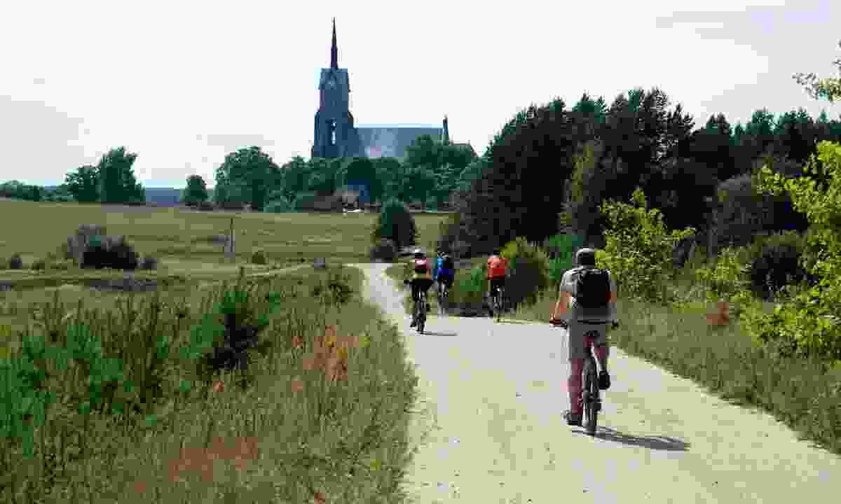 Cycling through the Lithuanian countryside (Shutterstock)