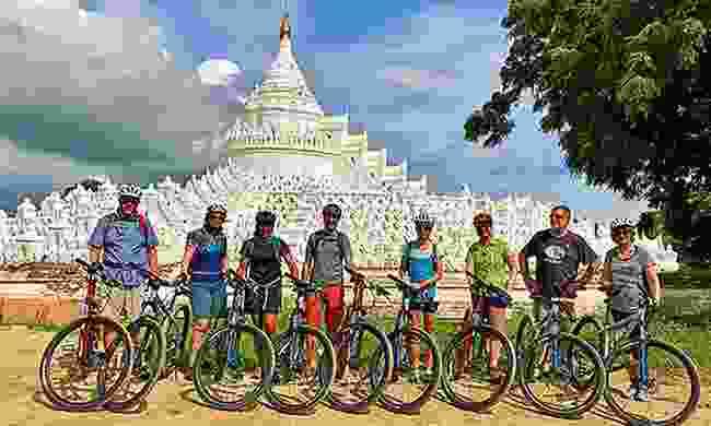Cyclists outside the White Pagoda (Intrepid)