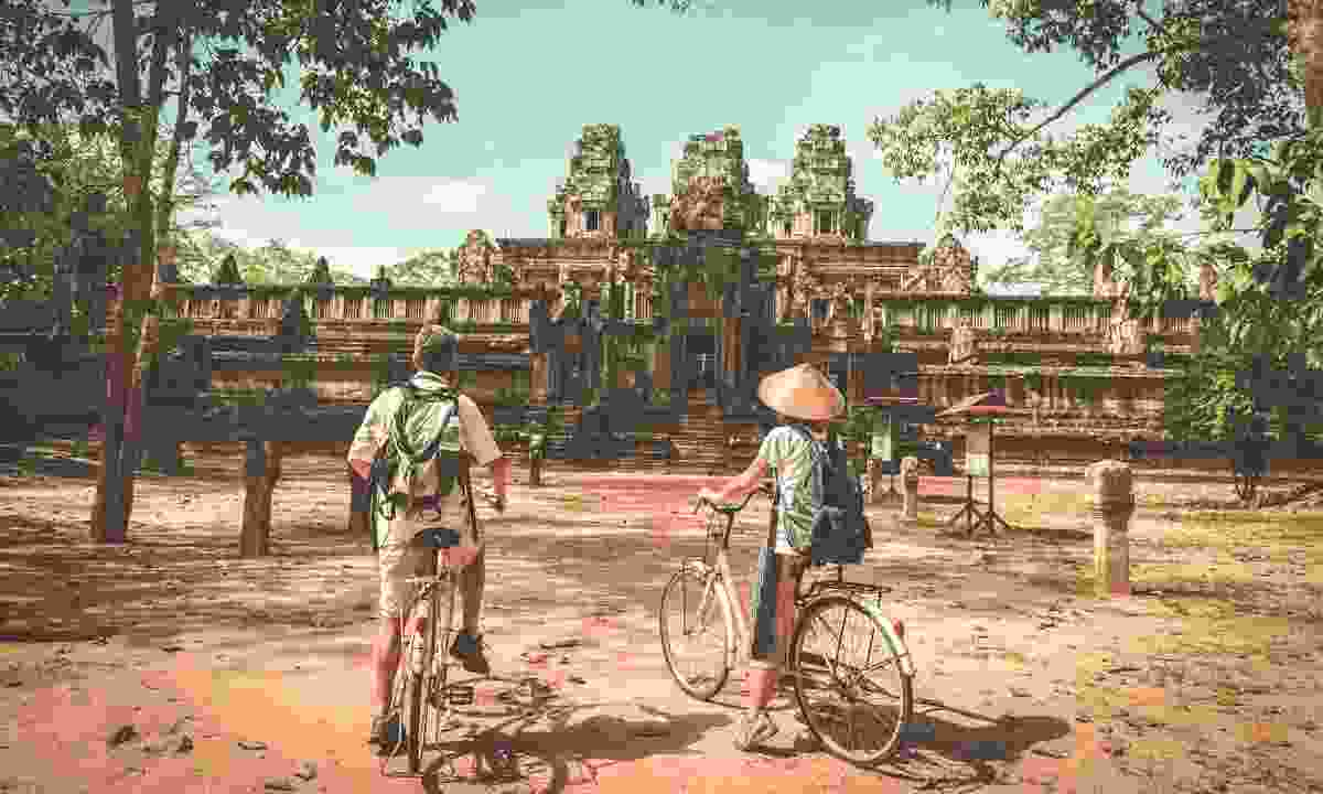 Cycling around Angkor Wat (Shutterstock)