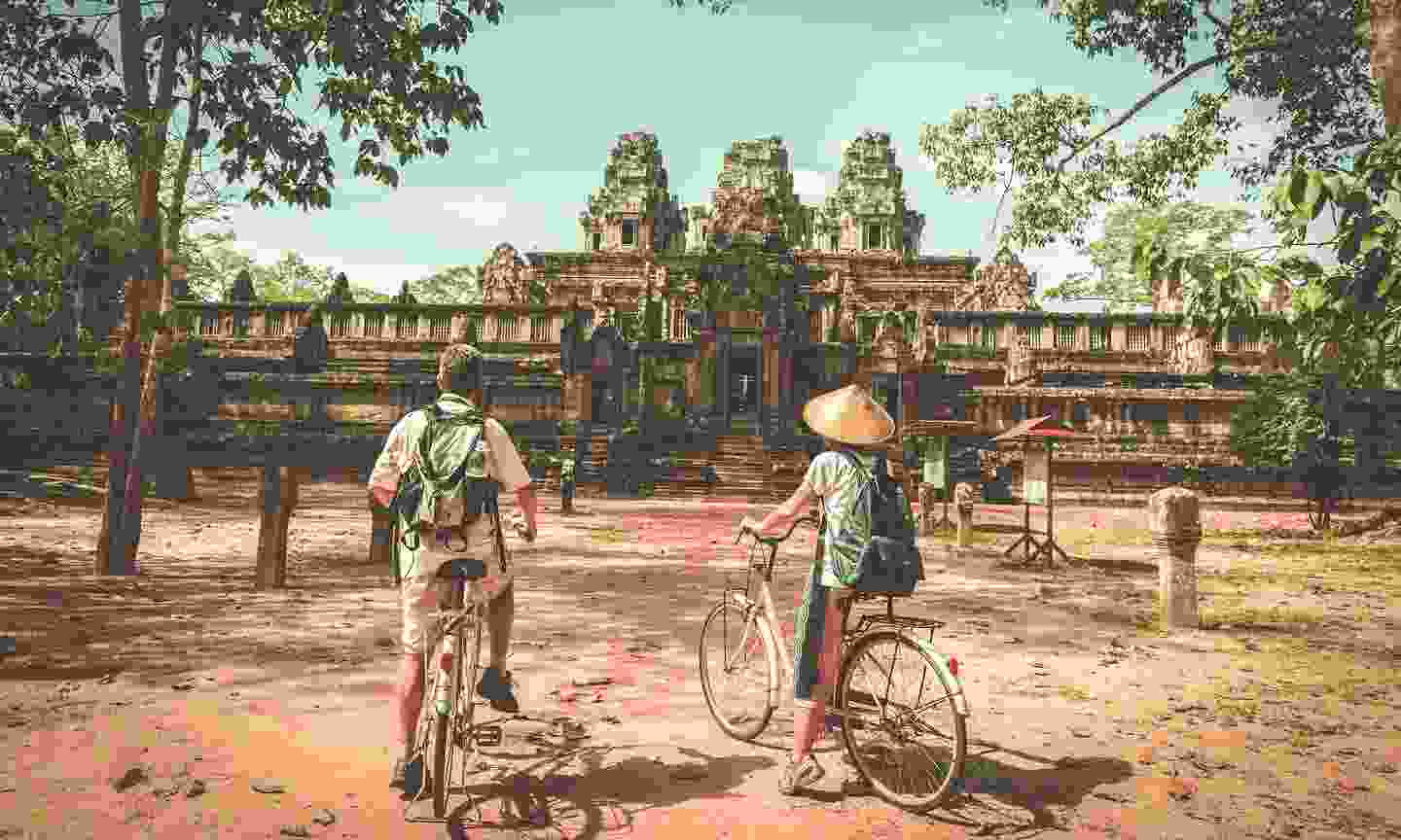 Cycling around Angkor Wat (Shutterstock)