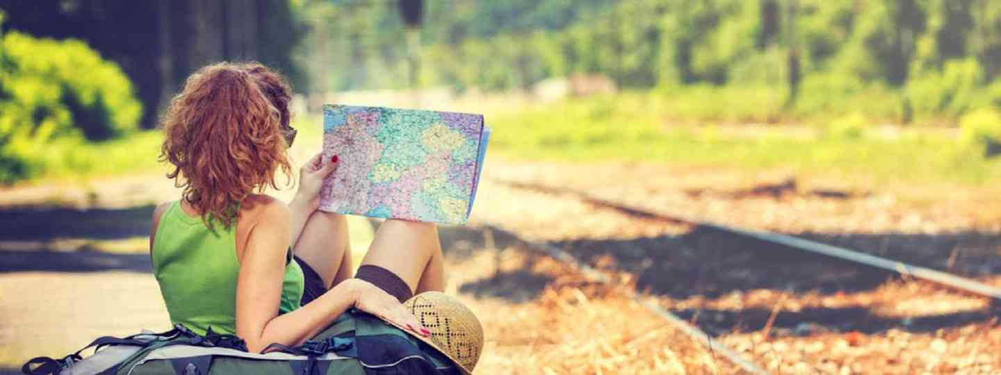 Girl wearing backpack, holding map (Shutterstock: see credit below)