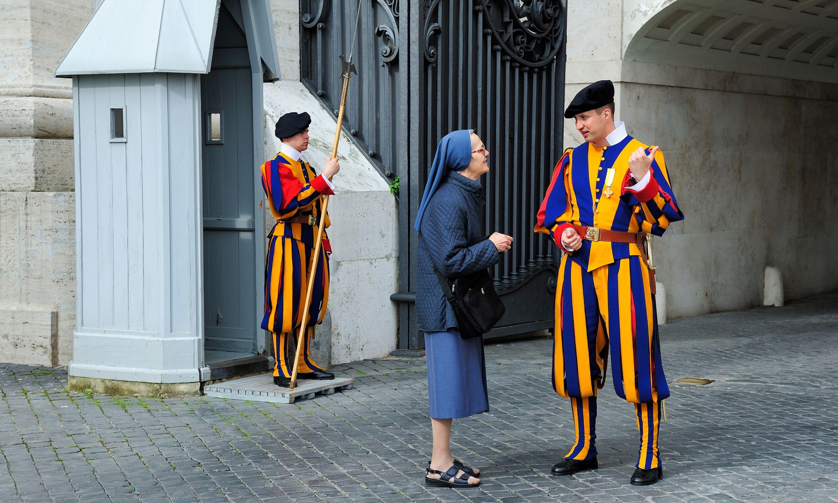 Swiss Guard chatting to nun (Shutterstock.com)
