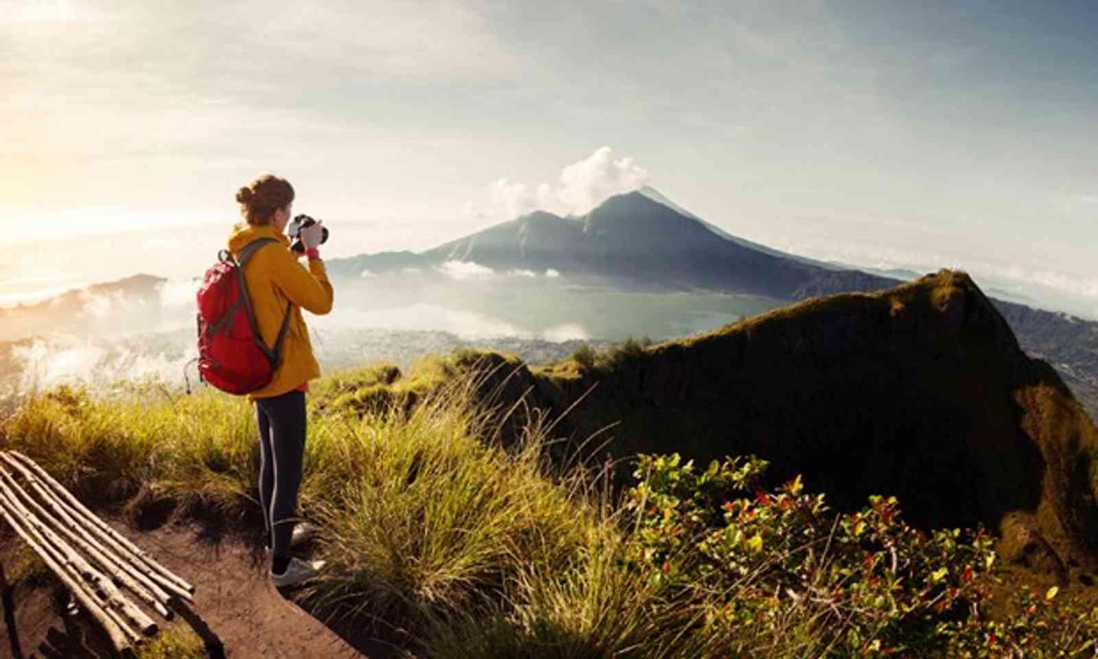 Hiker travel photographer (Shutterstock.com)