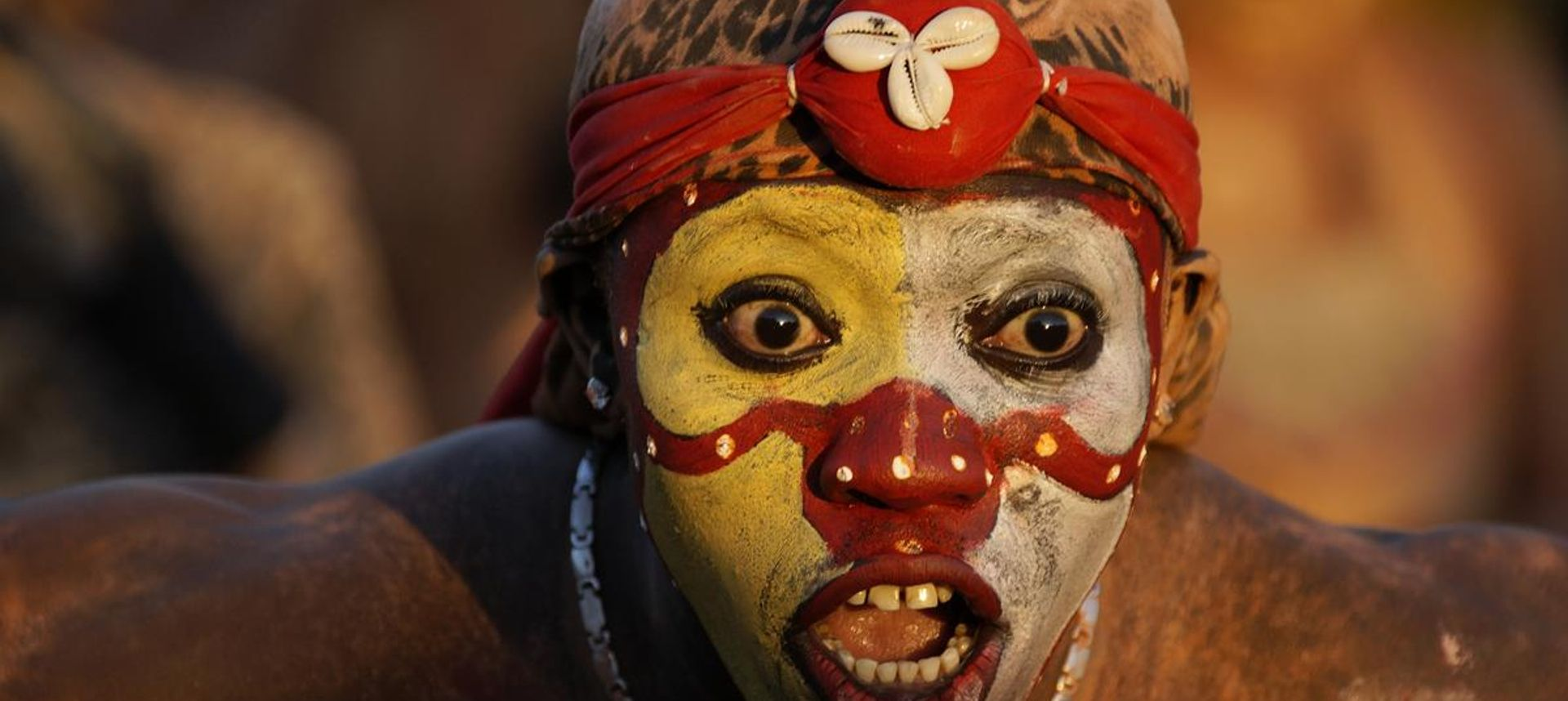 French Guiana, A young parade-goer participating in the French Guiana's Annual Carnival February 14, 2010 in Cayenne, French Guiana (dreamstime.com)