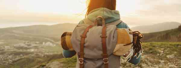 Hiking woman with backpack  (Shutterstock)