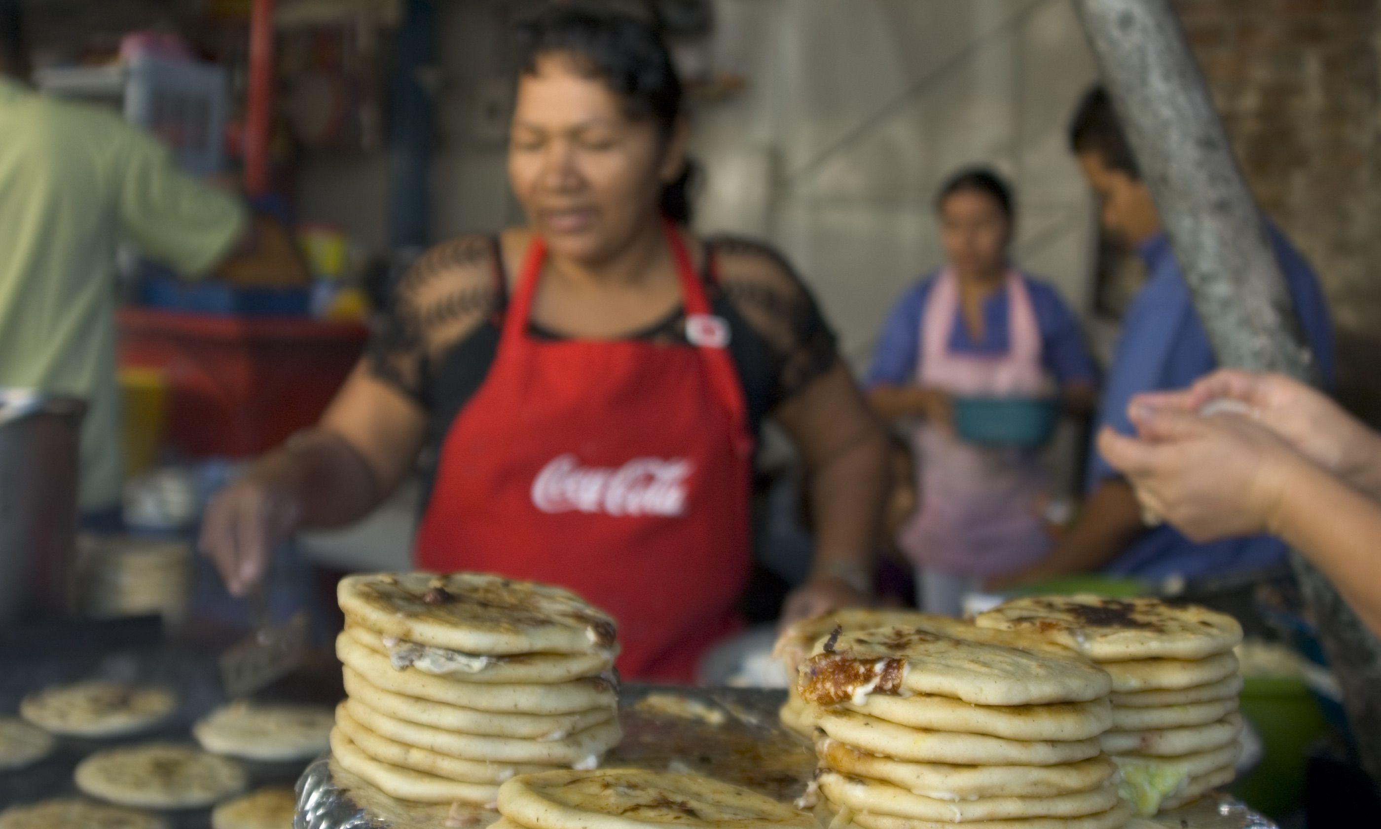 Pupusa seller (Shutterstock.com)