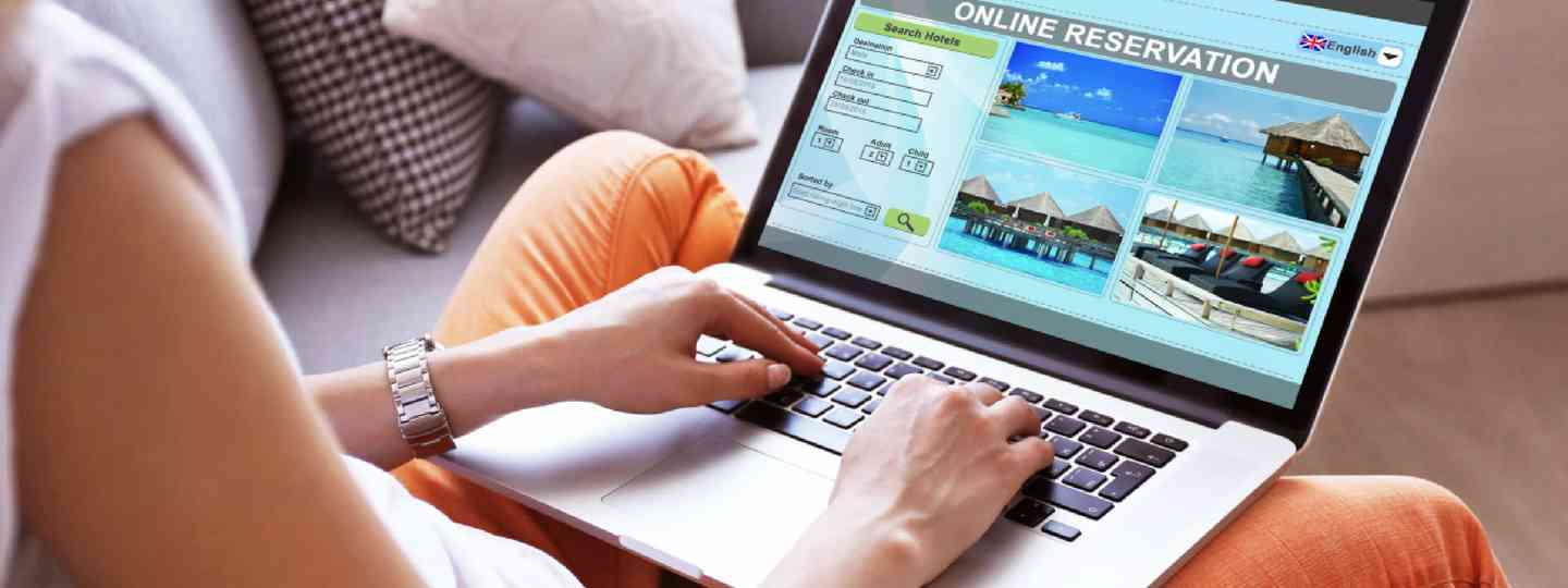 Booking holiday online (Shutterstock)