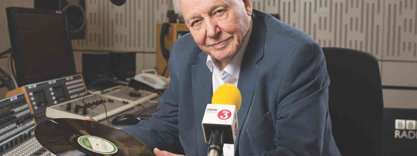 Sir David spinning disks in the BBC studios (©BBC Sophie Mutevelian)
