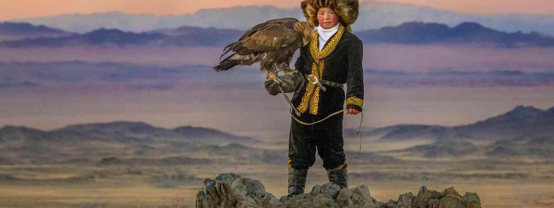 Aisholpan Nurgaiv and her golden eagle Akkanat