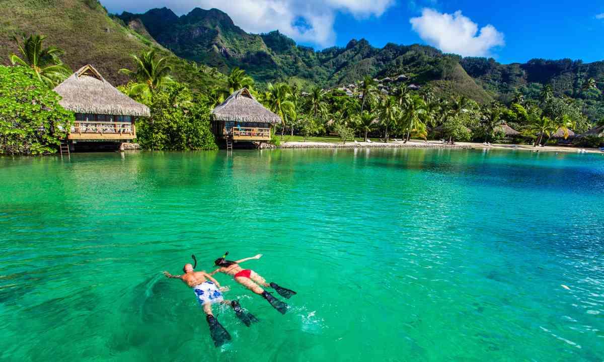 Snorkelling near overwater villas (Shutterstock.com)