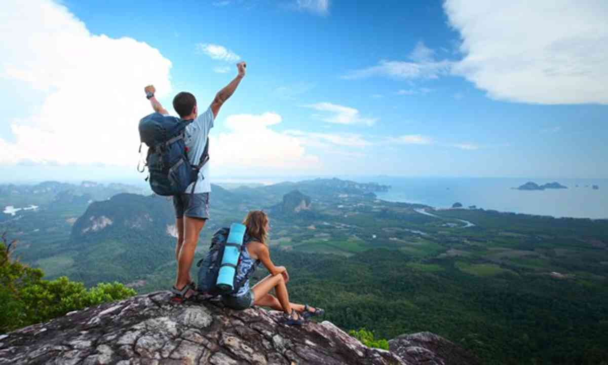 Backpackers atop a mountain (Shutterstock,com)