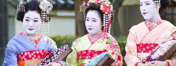 Young Japanese women called Maiko wear traditional dress (Shutterstock: see credit below)