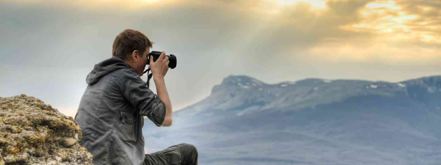 Nature photographer with digital camera (Shutterstock: see credit below)
